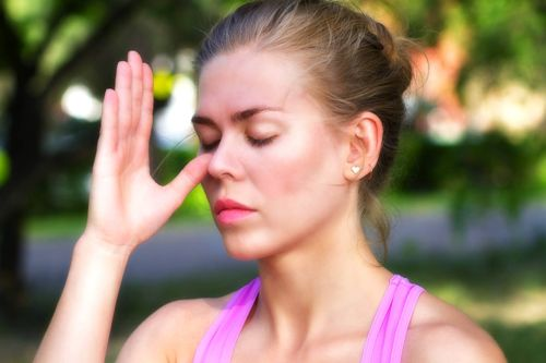 girl doing breathing exercises. pranayama and yoga.